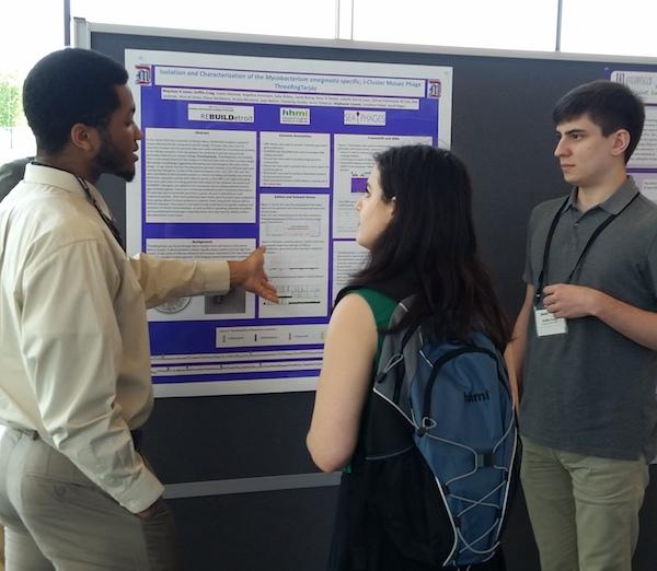 Alex Jones (l) and Griffin Craig (r) present poster at 9th Annual SEA-PHAGE Symposium in Ashburn, VA.